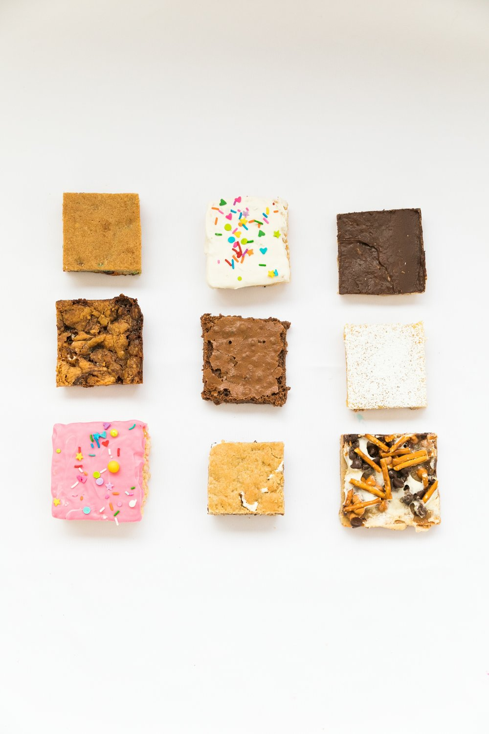 Delish bars in a variety of flavors with rice krispies treats, Marshmallow pizza bars, smores bars, and lemon bars