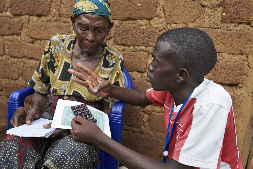 TB-REACH Community Health Volunteer, speaks with patient about her TB medication and explains her the importance of adhering to the treatment.
