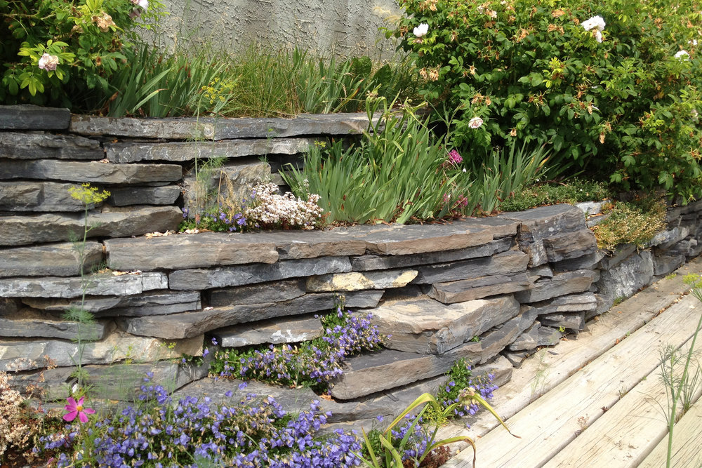 Stack flagstone for a beautiful and functional feature in your landscape.