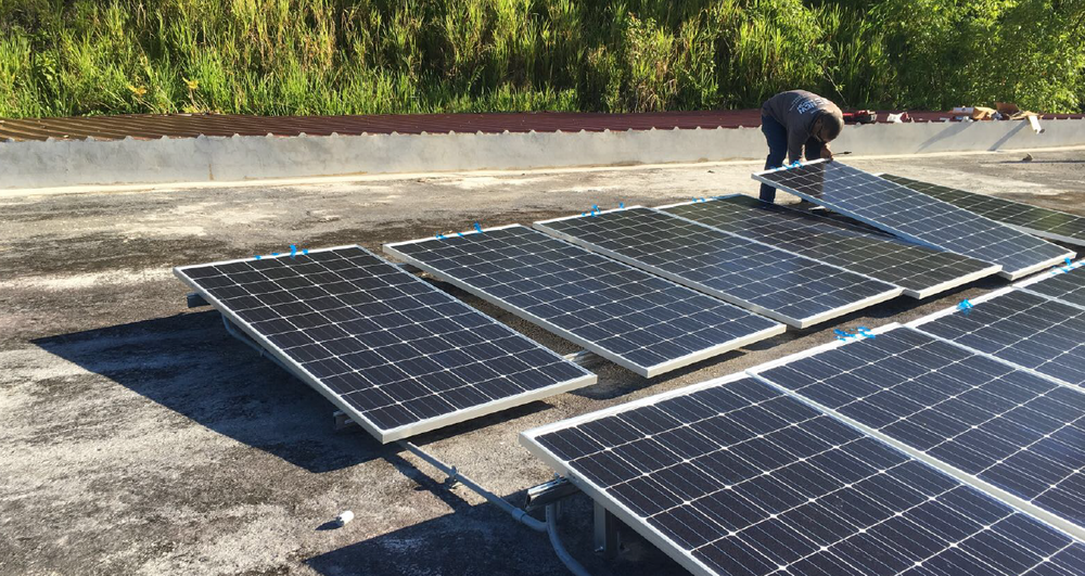 Solar panels being installed in Arecibo women's shelter, April 2018.