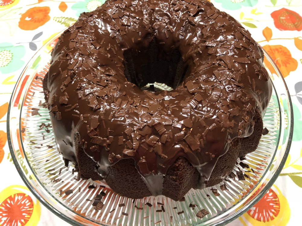 Drizzled with glaze and chocolate shavings.