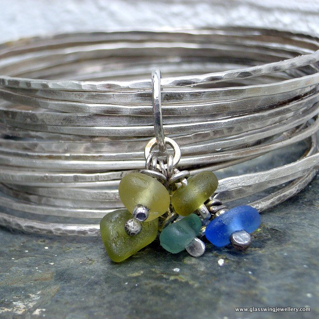 Fine stacking bangles with sea glass charms