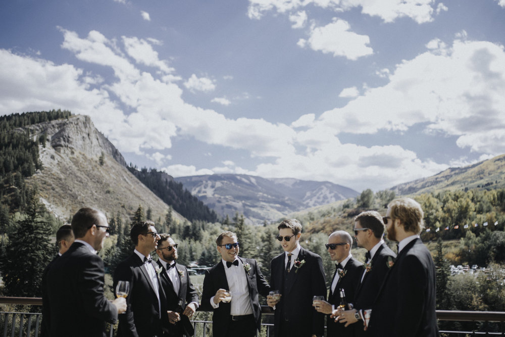 "we are ""one of the guys"" - My favorite part of the ""getting ready"" part of the day is when everyone is chilling and waiting for the ceremony to begin. I get to chill out with everyone and just take photos of you hanging out with your best friends. This groom in this photo handed me a beer on the patio in Avon, Denver and said , ""here, drink a beer and hang out with us."" No arguments."