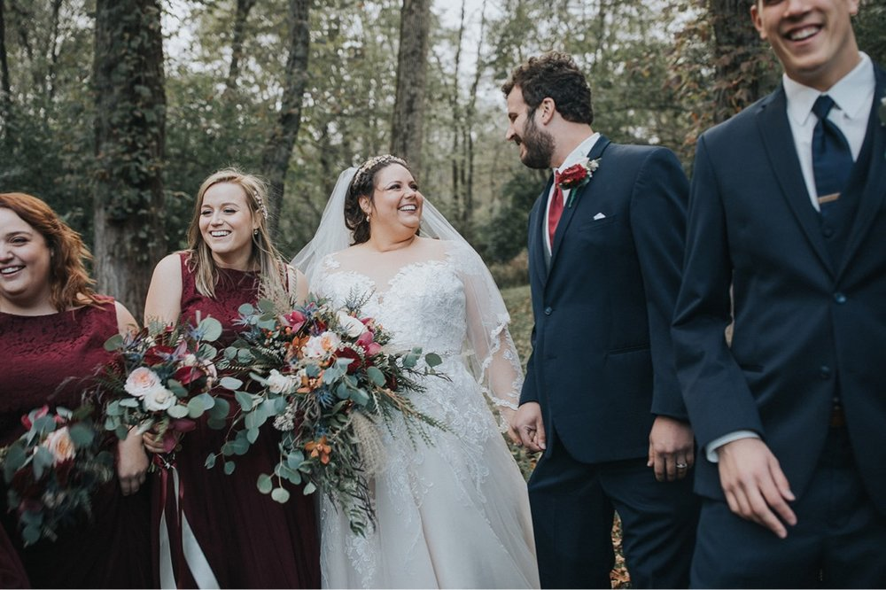 A photo of a wedding party, bride, and groom.