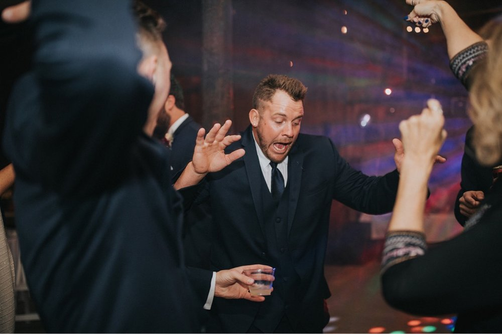 58_5W9A1207_Fun_adventurous_Wedding_Barn_Ohio_Party_natural_reception.jpg