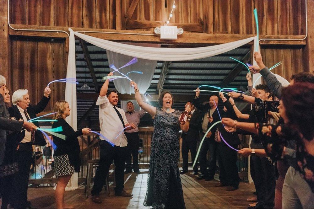 65_5W9A1698_reception_sparklers_send_Fun_adventurous_Wedding_Barn_Ohio_Party_Glowsticks_natural_Off.jpg