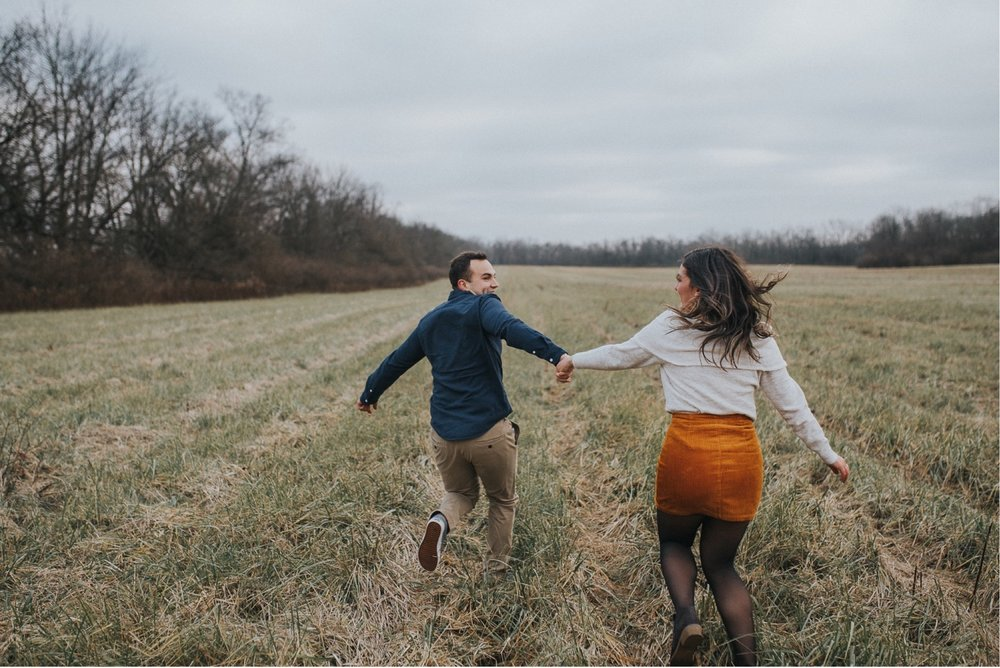 An engaged couple having fun at their engagement session