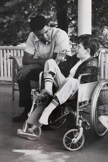"""Bob Massie, age 9, with Muhammad Ali in 1966. Photo by Gordon Parks"""