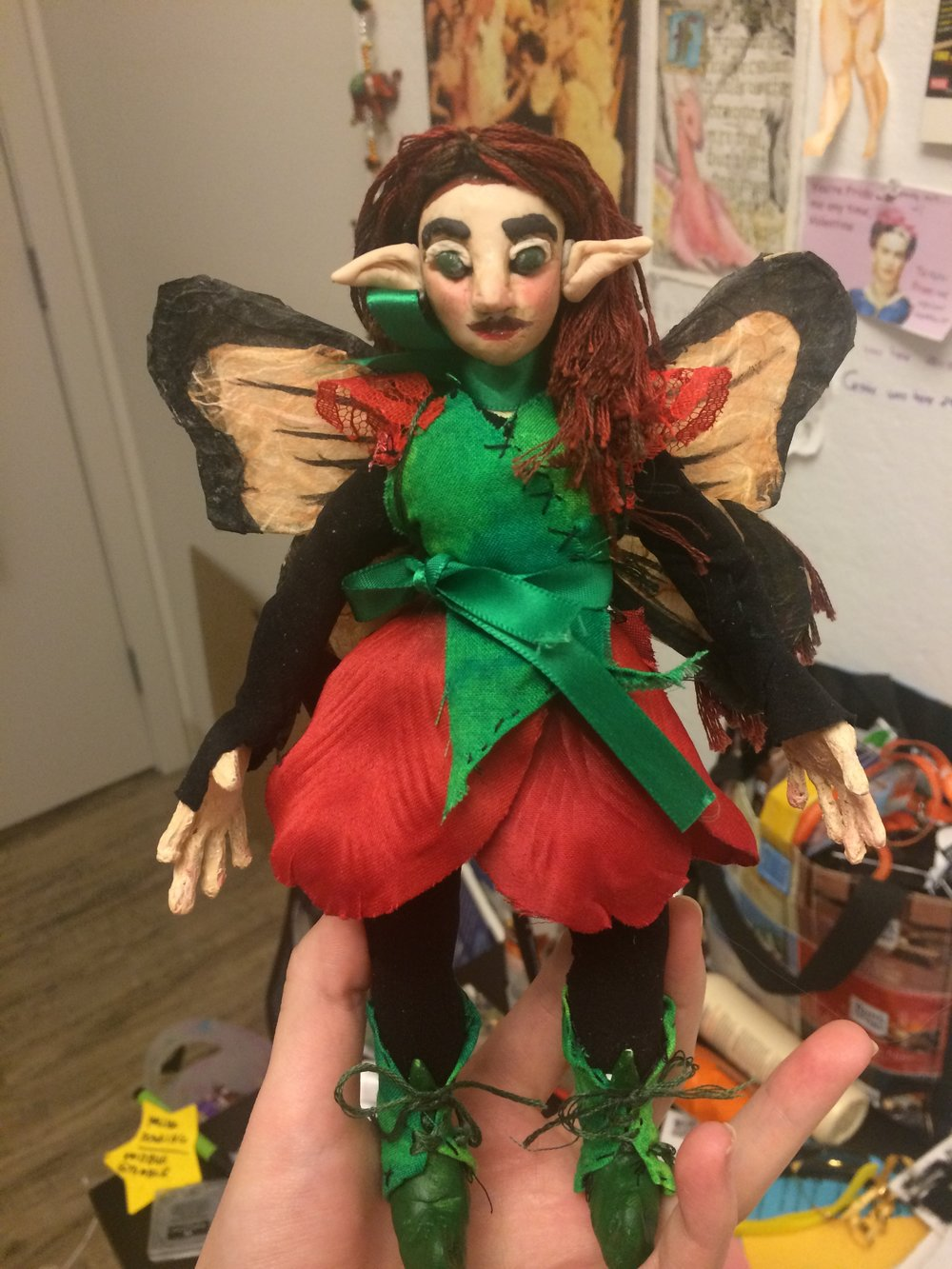 The puppet is 7 inches tall, with embroidery floss hair and a sculpey face. Her eyebrows and eyelids were left as soft clay to be animated.