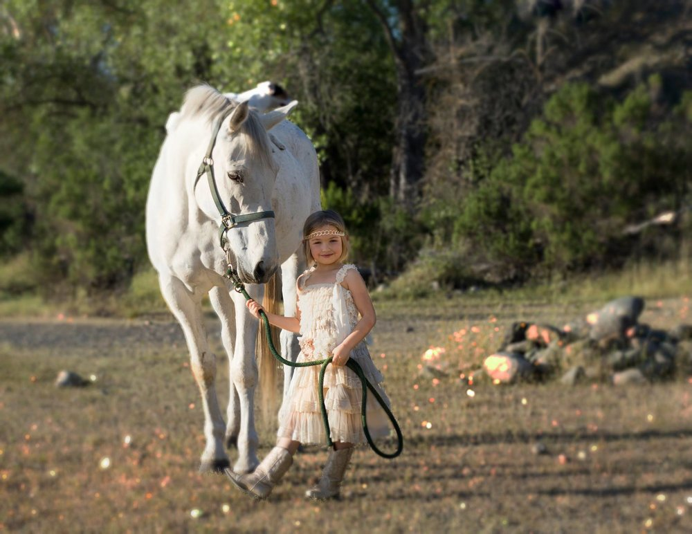 kid with white horse.jpg