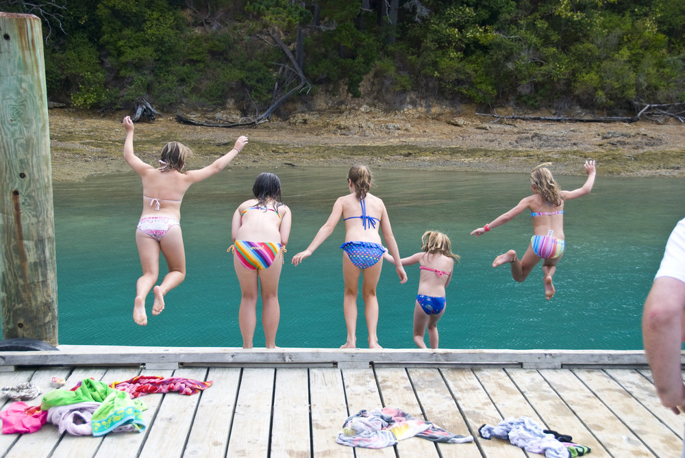 Kids jumping off the wharf