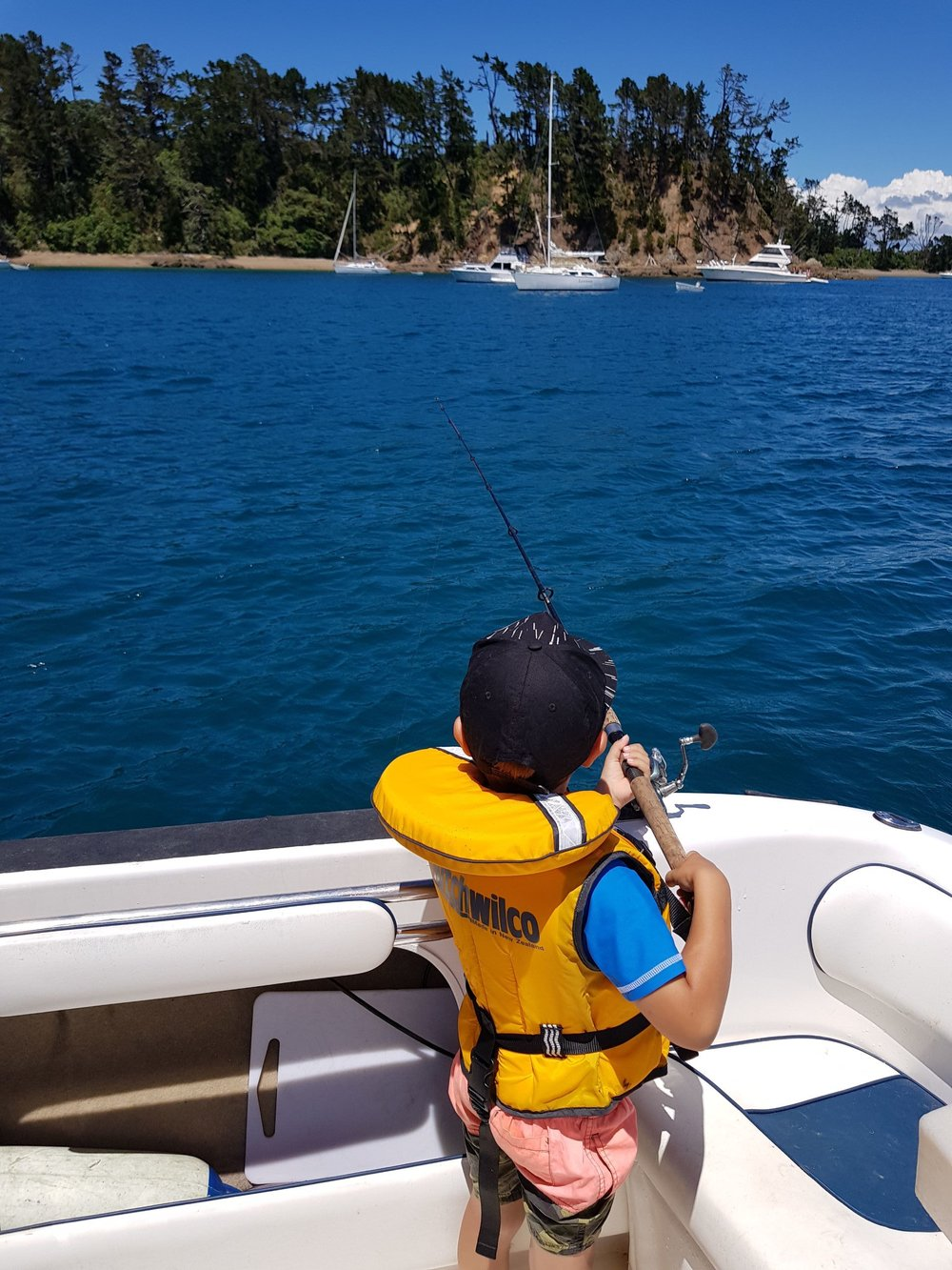 Family fishing in the bay, Kawau Island