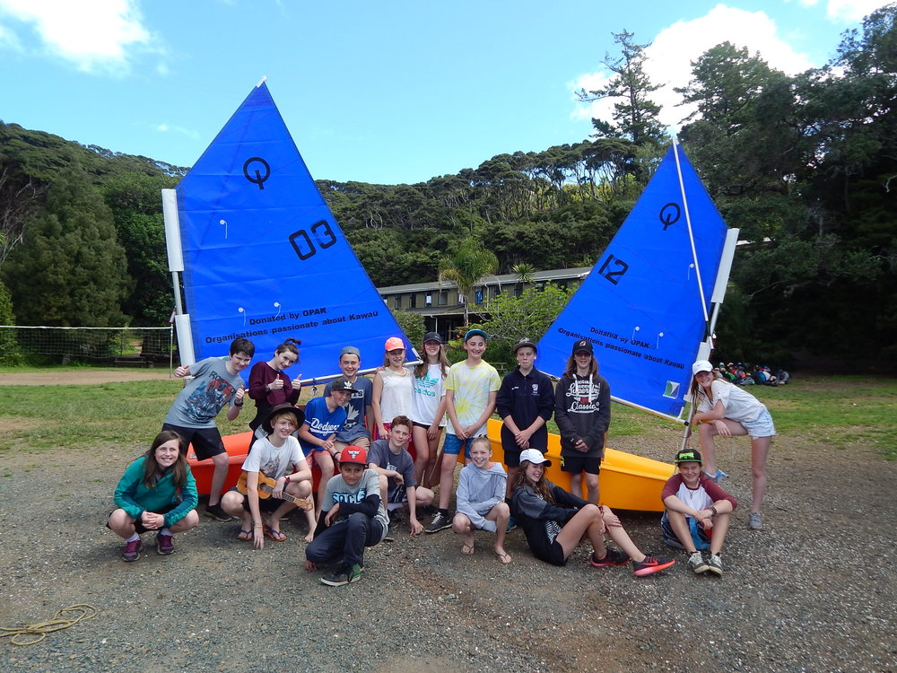 Teens enjoying watersports on Kawau Island