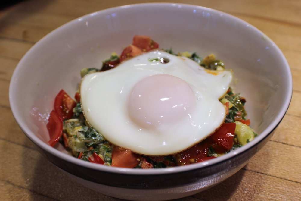 sauteed greens with egg on top.JPG