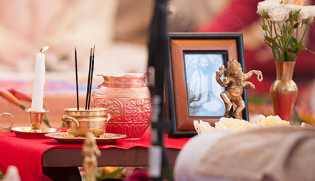 Altar showing candles, incense, flowers and a statue of dancing Ganesh from Mount Madonna Center.