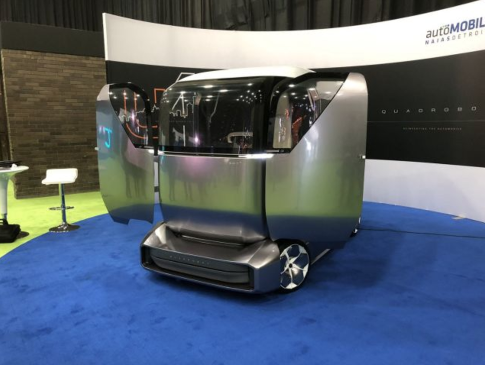 (Photo: Quadrobot's autonomous delivery vehicle, appearing at last month's Detroit Auto Show)