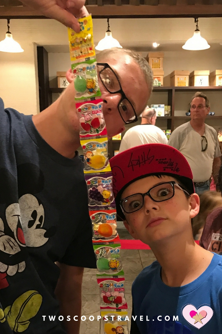 Teens enjoying Epcot candy challenge in Japan