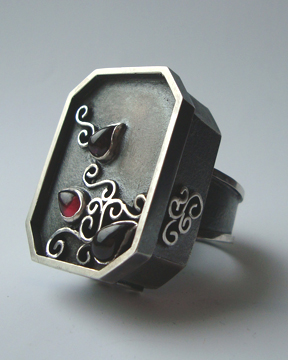 """Arms covered in swirling tattoos, with a toss of the locks that went all the way down his back, he told me """"I want a bold ring, one that will make people notice and not forget me"""". As if….this Haitian-born artist is far from a shrinking violet, and required a bold ring to match his unbound energy."""