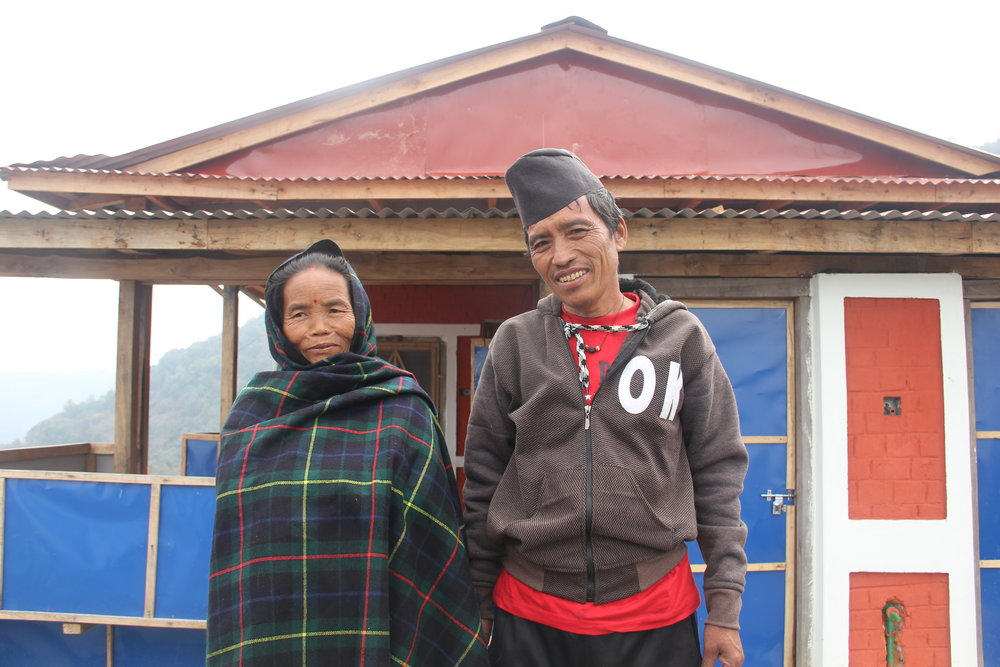 Tulsi Maya and Prasad Gurung in front of their new home.