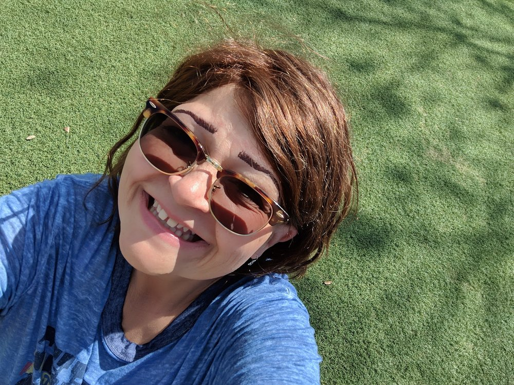 smiling in the sunshine on the hub grass