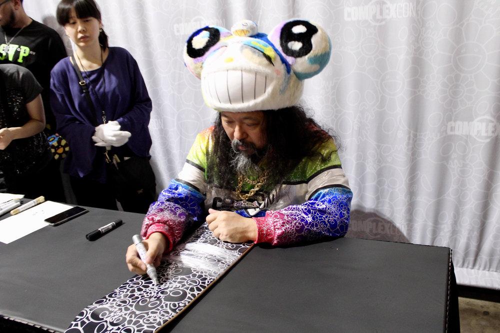 Takashi Murakami signing our deck