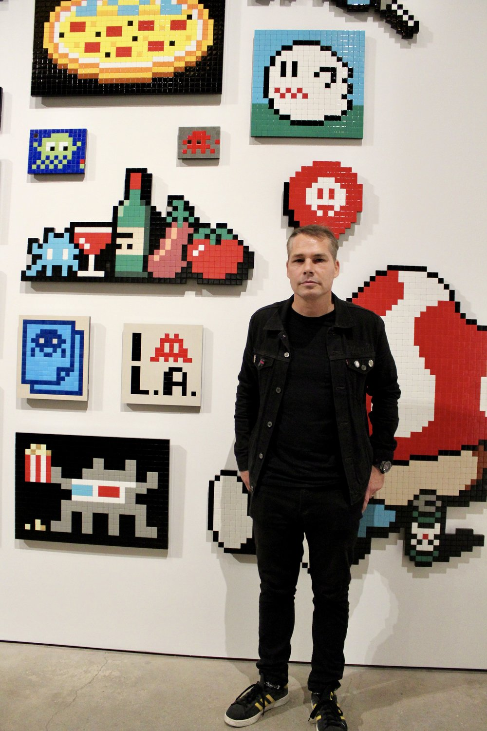 Shepard Fairey with Invader art