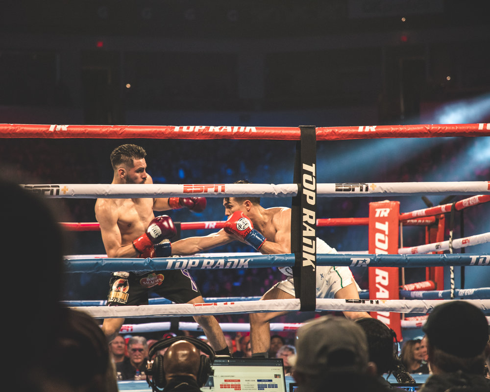 Jose Zepeda with a punch to the midsection of Jose Ramirez by Benny Blanco