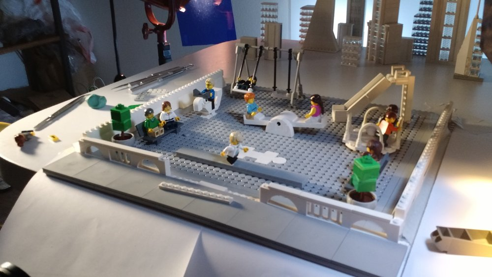 The playground set, with microscale buildings in the background