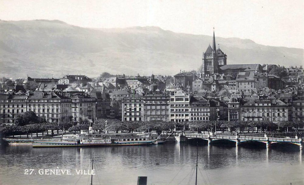Vintage postcard of Geneva with a view over the Old Town and Cathedral de St Pierre with in the background the Salève; in black and white.