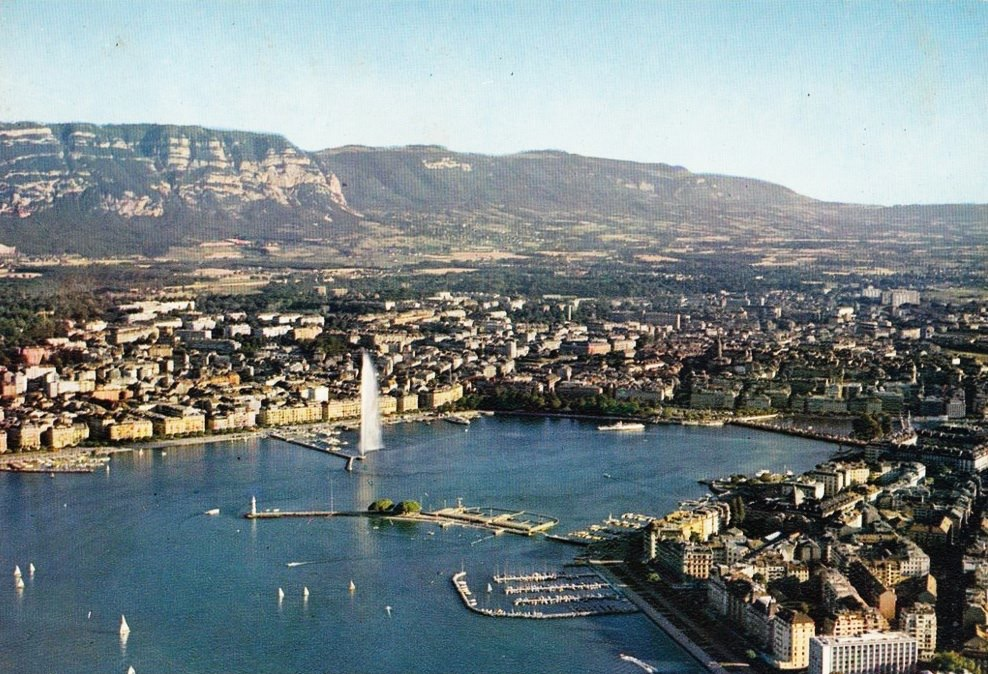 Vintage postcard of Geneva with an aerial view over Lac Léman, the Jet d'Eau and the Salève.