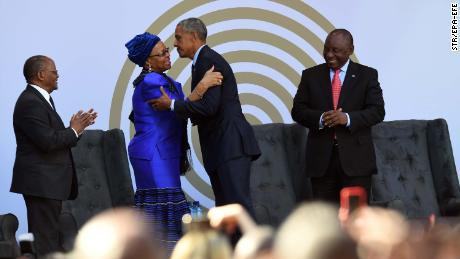 Nelaon Mandela's widow, Graça Machel, center left, greeting Barack Obama on Tuesday after his speech at the Mandela Day Celebration.
