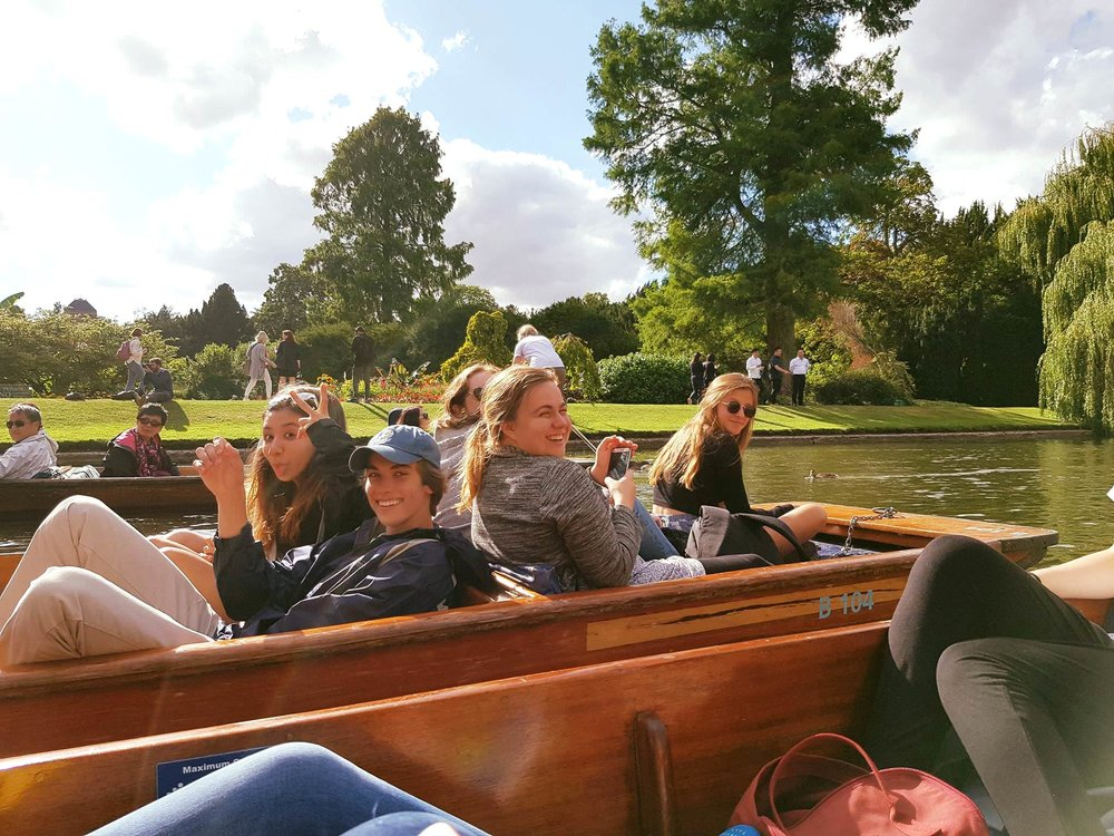 "Punting   Punting is a distinctly ""Oxford"" activity not to be missed. Glide elegantly along the banks of Oxford's River Cherwell in style accompanied by your new friends.  Be careful though - it's harder than it looks! After being chauffeured on a punt in Cambridge, it's time for students to learn themselves. Take care to look where you're going, and don't get the pole stuck in the muddy river bed or you might fall in!  Punting is always a student favourite on a sunny afternoon."