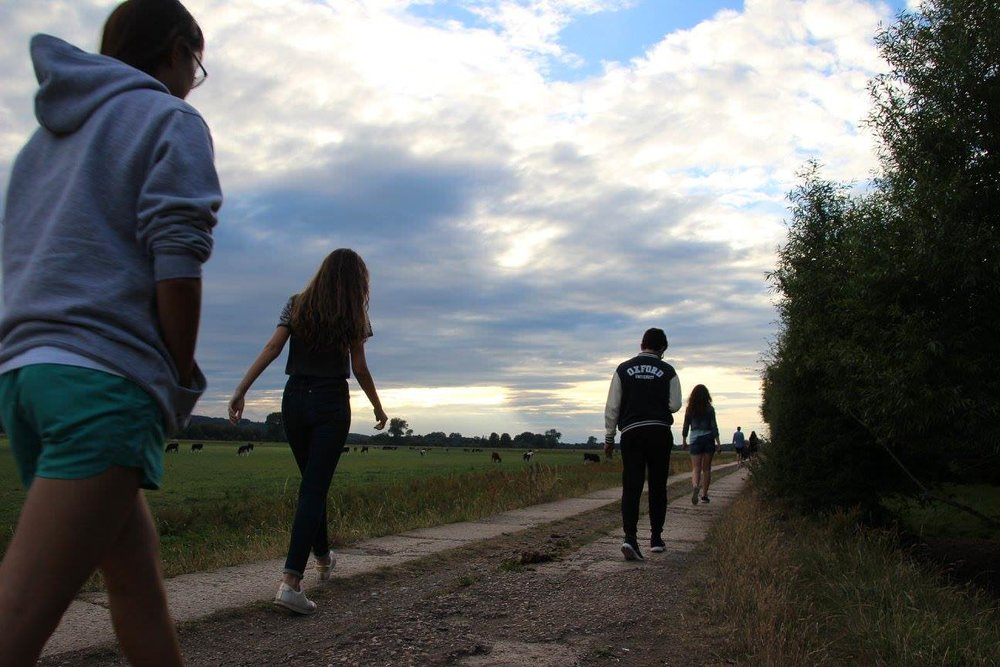 Summer School students walk in the Oxford countryside