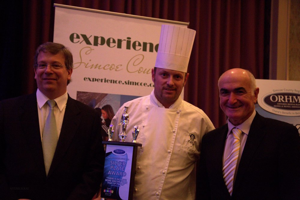 Chef/Kitchen Manager of The Year - This award is presented by the Simcoe Region of the Ontario Restaurant Hotel and Motel Association to a Chef or Kitchen Manager who has demonstrated leadership and innovation in the culinary arts and food service management. The winner will be someone who made a significant contribution to the advancement of the profession and industry through promoting the growth and success of their hospitality team and business.This individual:Has demonstrated leadership and innovation in integrating local foods and sustainable culinary practicesStimulates the local economy/hospitality industry by supporting regional programs and suppliersDisplays honesty and integrity in all practices while dealing with employees, industry partners and the publicIs employed by a restaurant or a foodservice establishment currently operating in the region OR is an independent owner/operatorThe award will be presented to the winner at the Simcoe Hospitality Awards Gala