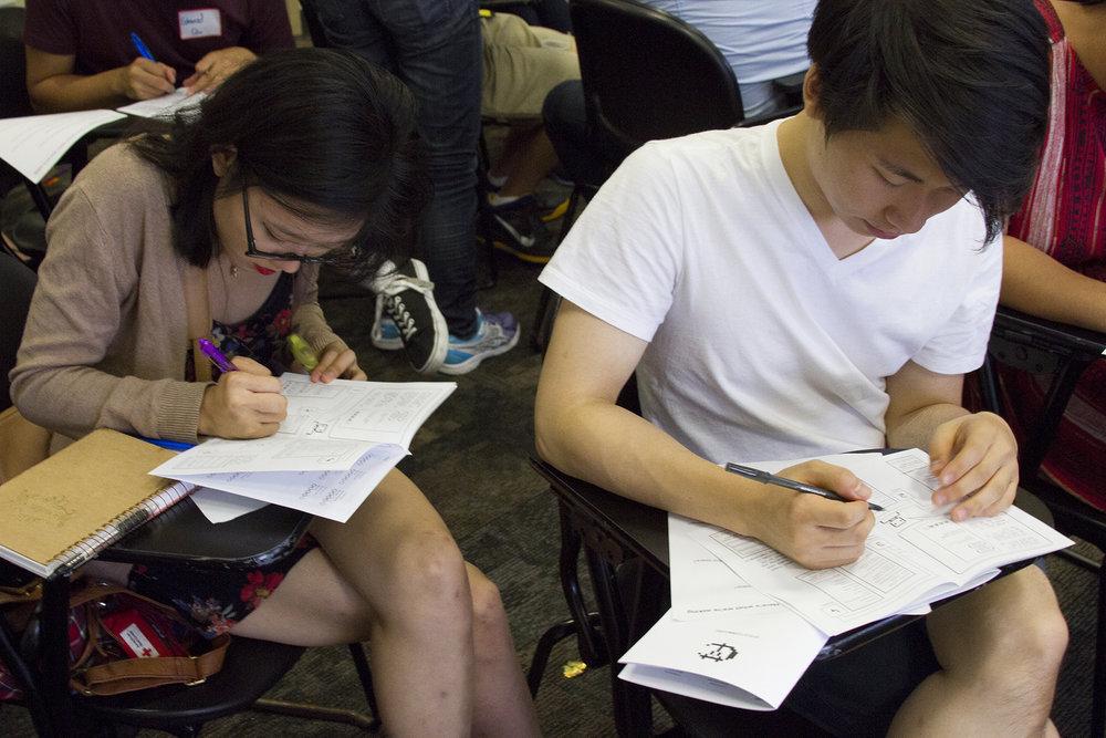 Conference participants filling out surveys.