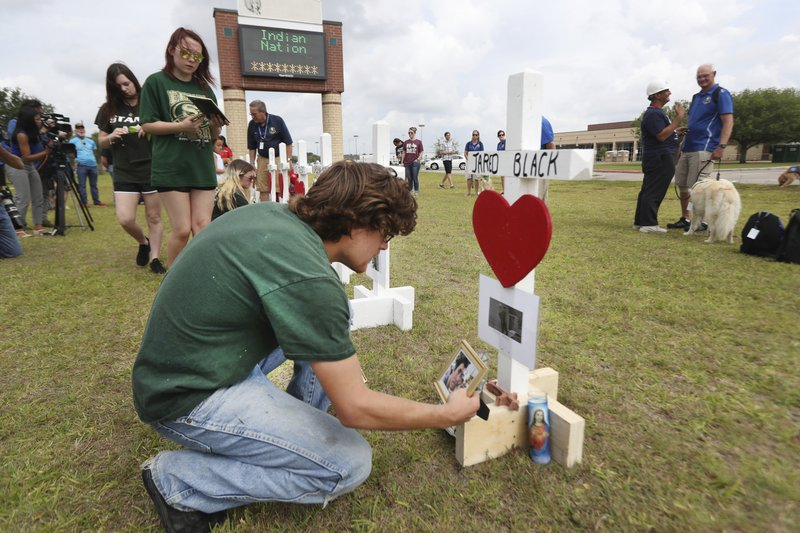 1.       Santa Fe High School students, parents and the community observed a Moment of Silence Monday, May 21, 2018, in Santa Fe. Texas Governor Greg Abbott has called for a moment of silence at 10 a.m. Monday morning to remember the victims of the Santa Fe School Shooting. (Steve Gonzales/Houston Chronicle via AP)