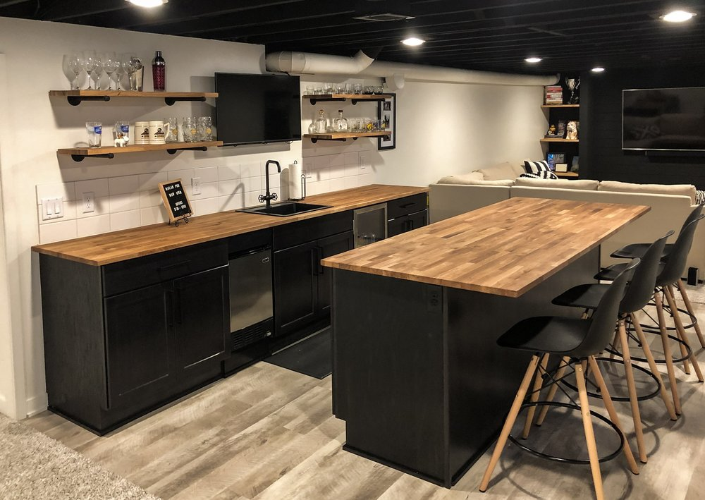 Nolan Basement Crib - 900 SF Basement Finish, Added wet bar and bathroom, Ship Lap, TV wall, Floating shelves with industrial pipe brackets, Butcher block counters