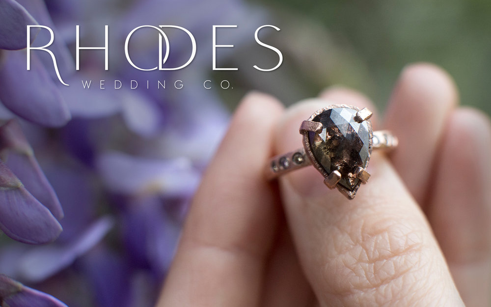 RHODES WEDDING CO.  Their hand carved wedding bands + engagement rings are much more than mass-produced pieces of metal. The rings are about you—an heirloom to be cherished + passed down through generations.       Leave a Review