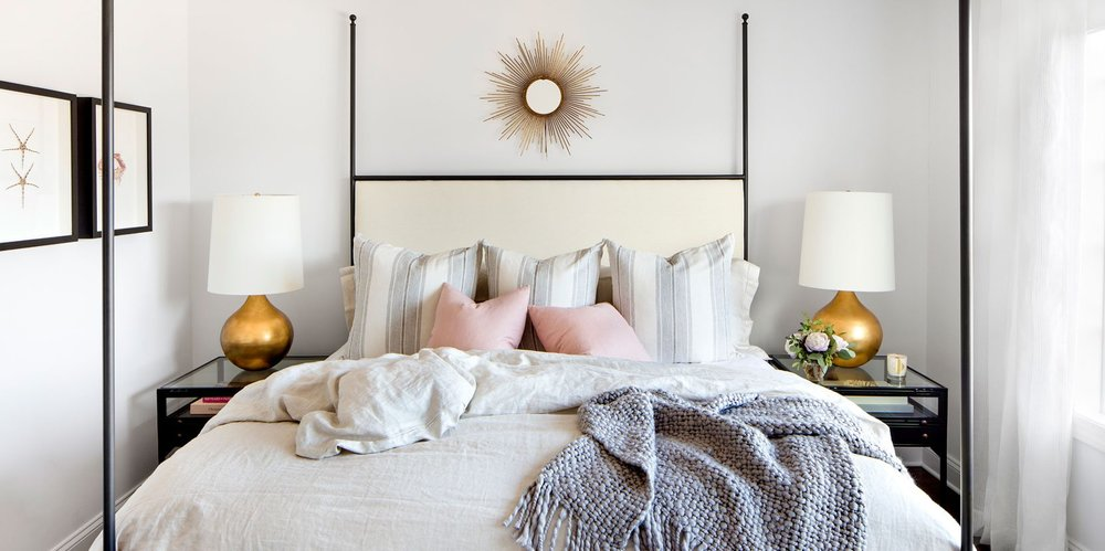 This happy bedroom by Bria Hammel Interiors is brought to you by a bright white upholstered bed, blush accent pillows, natural light, and last but not least- MIXED METALS!  How powerful are the warm gold lamps, iron bed frame, and cheery soft gold starburst mirror?  They make the room, I'm tellin' ya!  Image Via Bria Hammel Interiors.