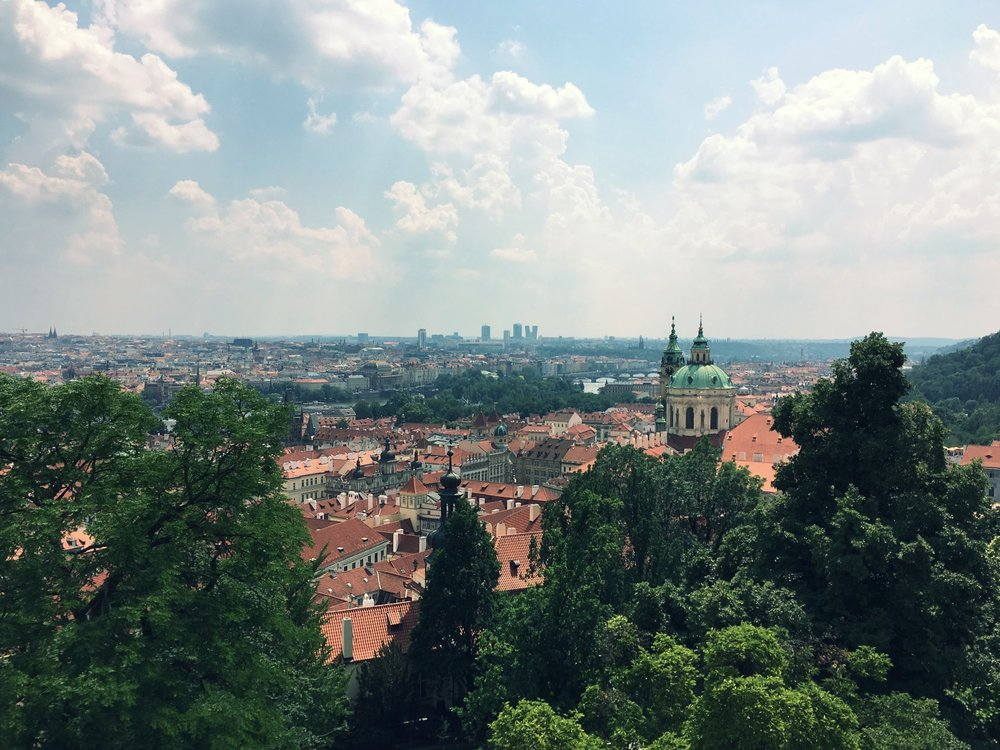 Gorgeous patinaed copper roofs contrasting with terra-cotta tiled roofs.  View of the city from Prague Castle.