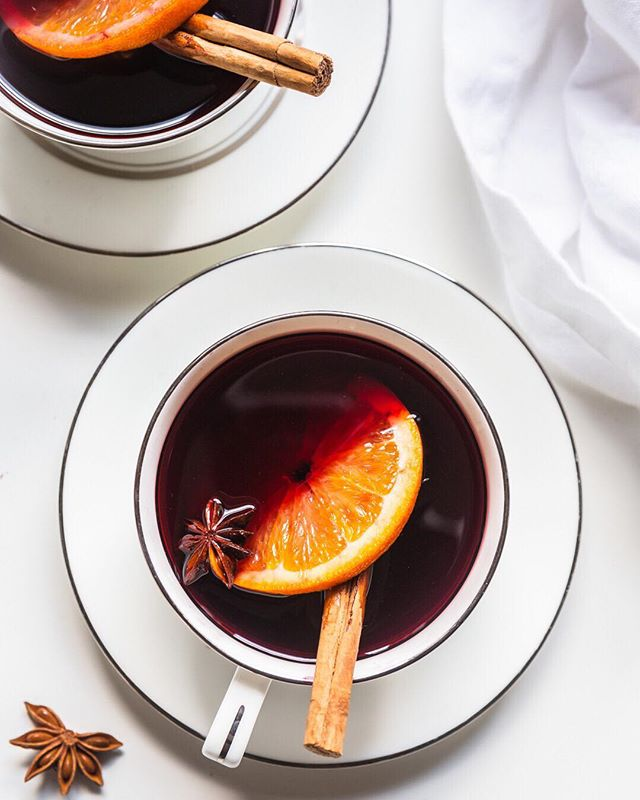 Just catching the last bit of chilly weather with this Mulled Red Wine with Orange and warming spices. @nytimes recipe. . So happy with how this picture turned out, especially because these teacups are from a china set that Dillon's Grandma passed down to me. Love me some vintage! ☺️ . . . #wine #mulledwine #winterdrinks #cocktails #glutenfree #cinnamon #orange
