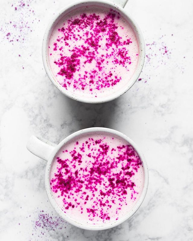 Pink Moon Ayurverdic Lattes to add some calm to your life this week!! 💗💗 ⠀⠀⠀⠀⠀⠀⠀⠀⠀ Ashwagandha has been used in ayurveda for thousands of years. Known for its adaptogenic properties some of which include : lowers blood sugar levels, reduce cortisol, boost brain function and help fight symptoms of anxiety and depression. ⠀⠀⠀⠀⠀⠀⠀⠀⠀ On weeks that are especially stressful, I ll add some to my tea or golden milk and have noticed it definitely calms me down and feel much better. ⠀⠀⠀⠀⠀⠀⠀⠀⠀ Recipe below! ⠀⠀⠀⠀⠀⠀⠀⠀⠀ Ingredients 1 c coconut milk (or any milk that you prefer) 1 c water 1 tsp ashwagandha 1/2 tbsp maple syrup  1 tsp rose syrup 2 tsp pitaya or beet powder 1/4 tsp cardamom powder 1/2 tsp MCT oil  A pinch of salt ⠀⠀⠀⠀⠀⠀⠀⠀⠀ Directions Add water, coconut milk, maple syrup and rose syrup to a pot and bring to a simmer. Transfer to a blender and add cardamon, ashawgandha, mct oil and pitaya powder, blend on high for 1 min. Transfer to cups, garnish with pitaya powder and serve. . . . #latte #pinklatte #pinklattes #drinkinspo #pinkdrinks #ayurveda #hotdrinks #thefeedfeed #feedfeed #adaptogens #adaptogenic #mctoil #coconutmilk #vegan #glutenfree #glutenfreerecipes #foodphotography #foodstyling #heresmyfood #vegandrinks ⠀⠀⠀⠀⠀⠀⠀⠀⠀ ⠀⠀⠀⠀⠀⠀⠀⠀⠀