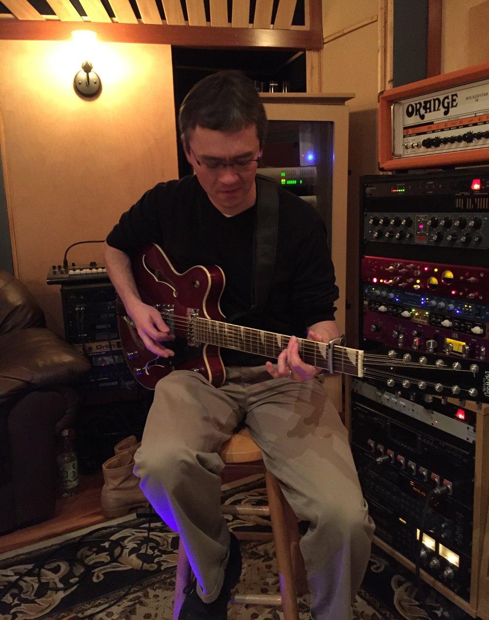 Guitarist Myron Kibbee recording 12 string guitar.