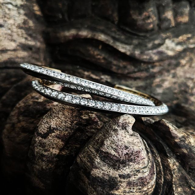 A pair of knife edge cuffs, with half side pave with white diamonds. #mrlieou #Diamond #cuff