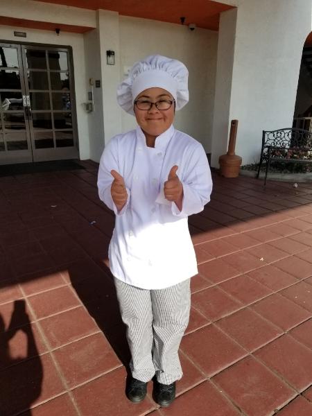 Itzel in her chef jacket