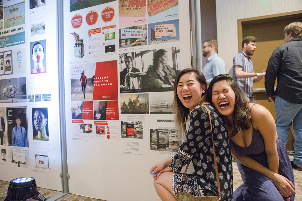Grace Liu (left) and Jennifer Diep (right), both students at the University of Texas, pose in front of their campaigns.