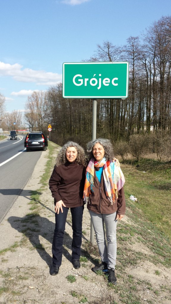 With my cousin, Linda Motzkin (right), in 2014 at the entrance to our parents' hometown of Grojec, Poland.