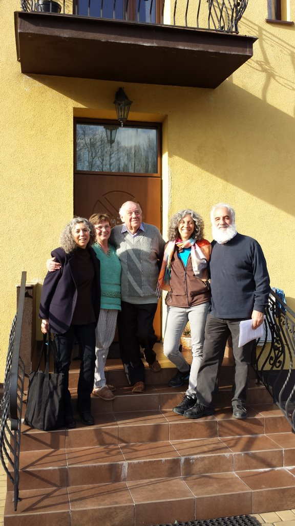 At the home in Grojec, Poland, where my father, his parents, and his sisters lived until November 1937: With my cousins Linda and Jonathan (at right), and with Teresa and Zenon Klim (center), the Polish couple who now own the house