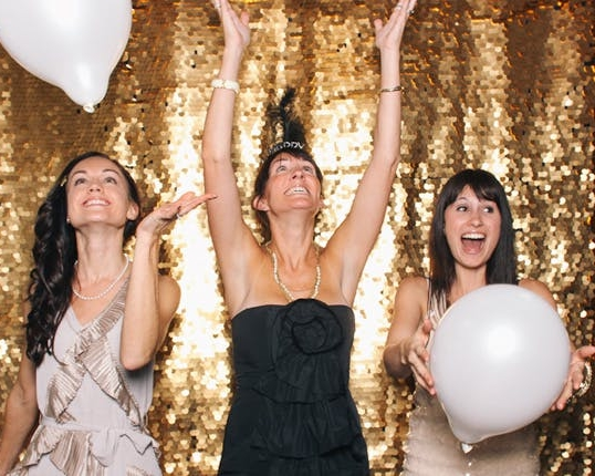 BACKDROP   Want extra pizazz for your photos? We have backdrops to spice up your photo booth. Pre-set backdrop options are: gold glitter, soft tulle, glittering chevron, and elegant black.