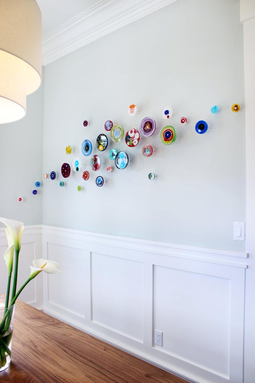 Artwork by Klari Reis. Residential Installation. 30 piece multicolor amorphous petri dish installation.